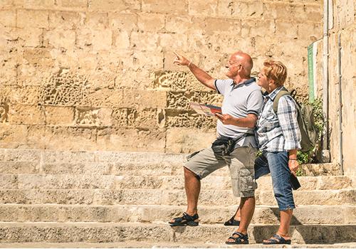 Bigstock-Happy-Senior-coiple-exploring-107889212-walking-tours